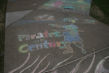Image of a cartoon pirate drawn on the sidewalk with chalk.