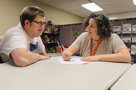Image of student with an advisor.