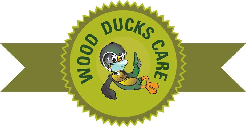 Badge graphic with Woody the Wood Duck wearing a mask