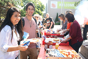 Students at a BBQ on West Campus.