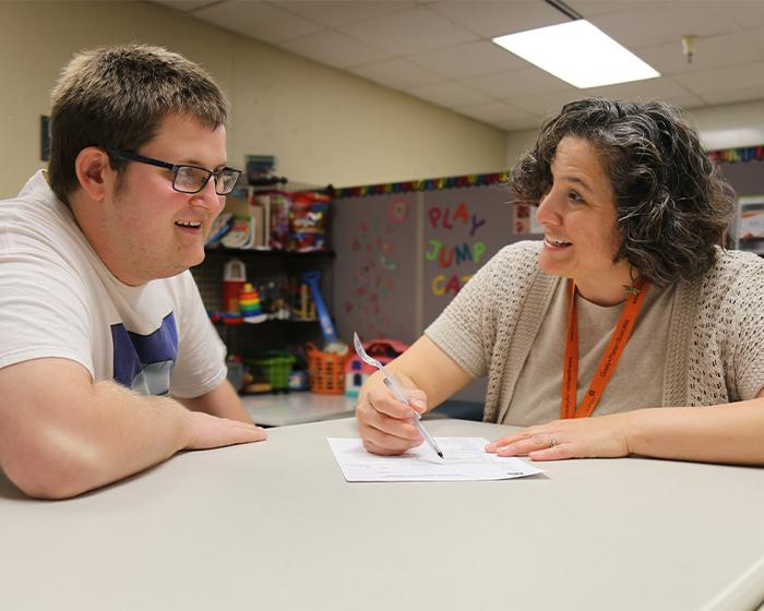 Counselor talking to a student
