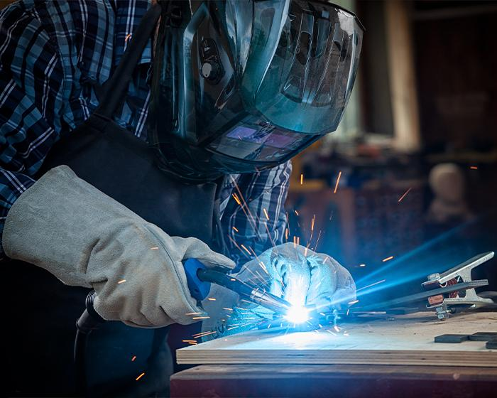 A welder welding a piece of metal