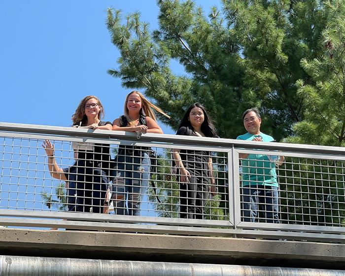 Group of student standing on the bridge