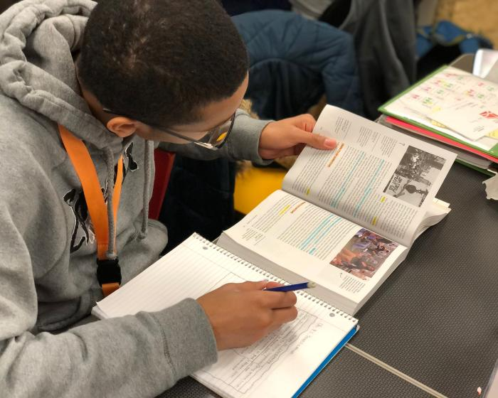 Student studying a textbook.