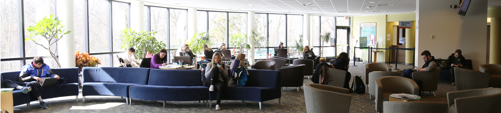 Students sitting and studying at west campus commons area.