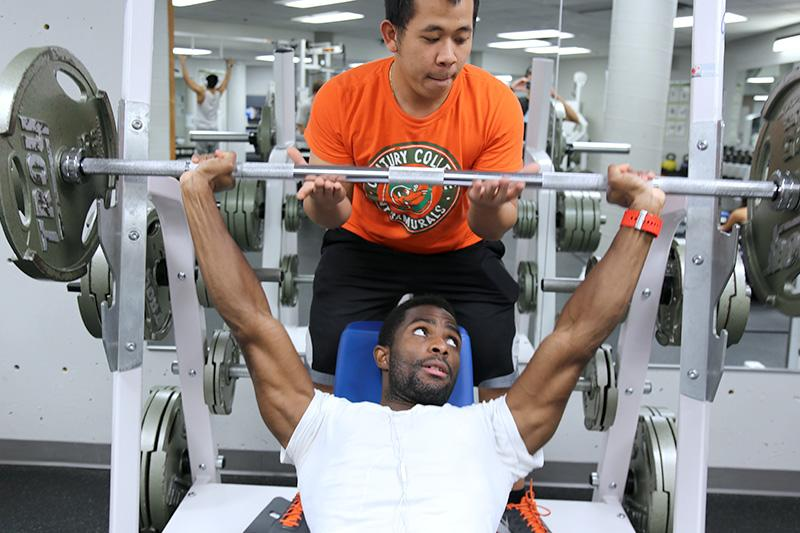 Image of student lifting weights.