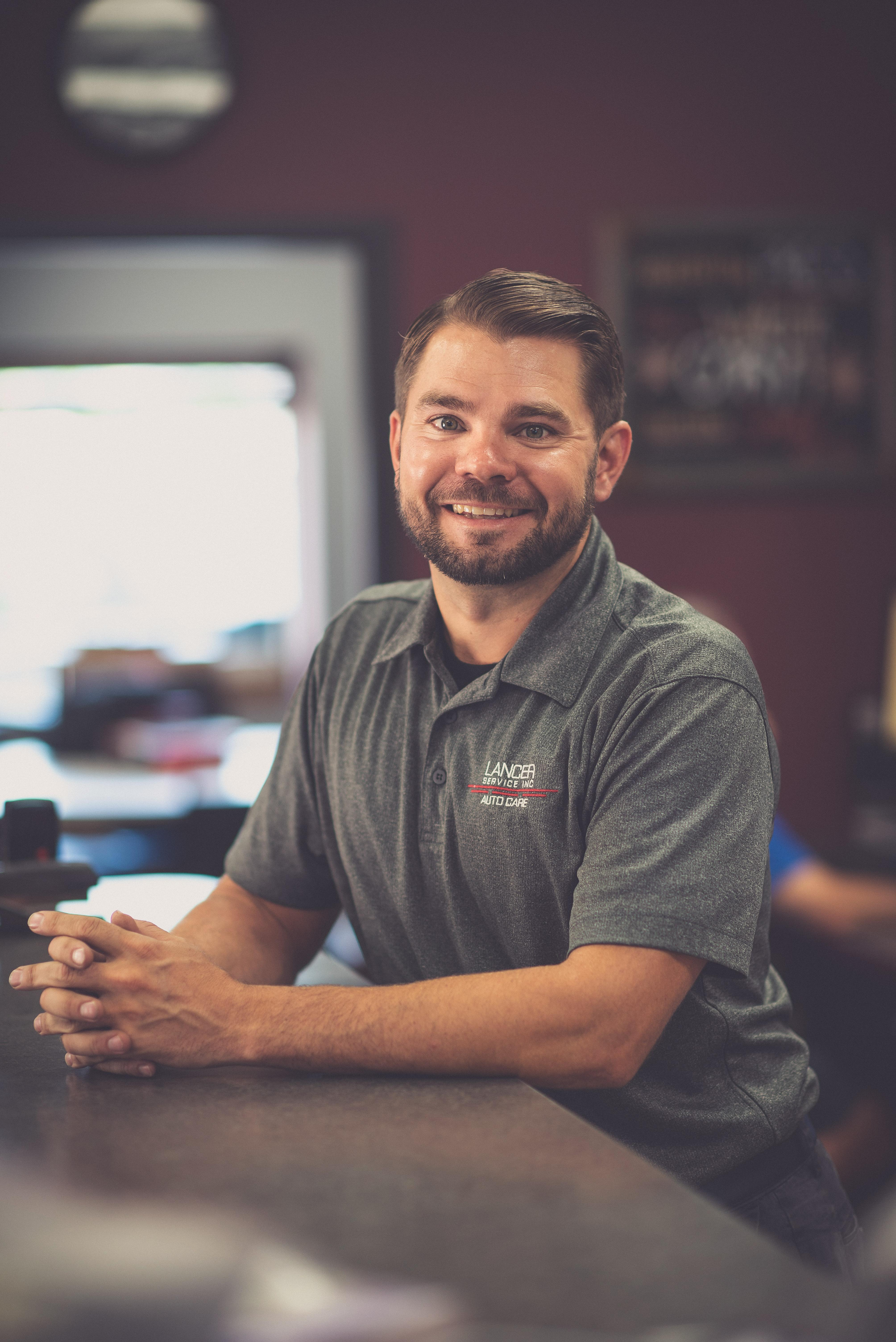 Portrait of Carl Thomas indoors at his auto repair shop.