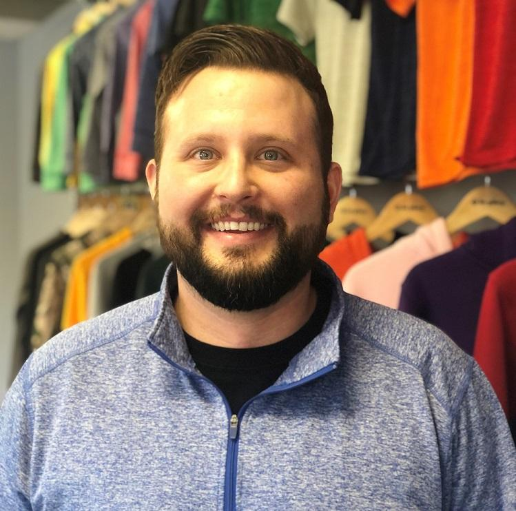 Portrait of Kyle Kasprzyk at a clothing store.