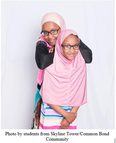 Two young girls smiling and posing.