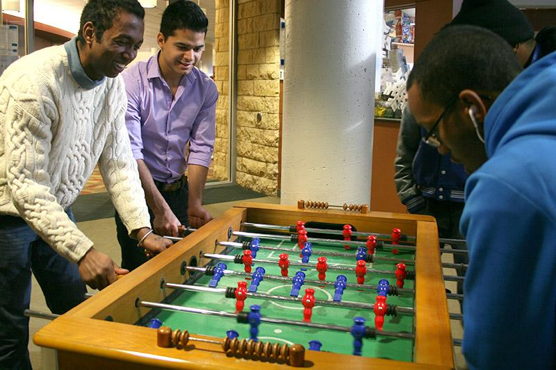 Image of students playing foosball.