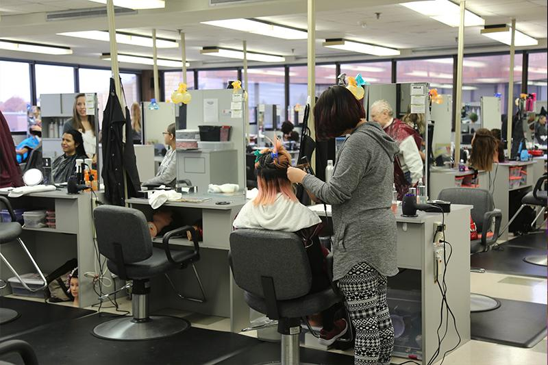Students working in the Century College 120 Salon.