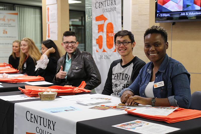 Four students sitting at the Tabling space at Century College.