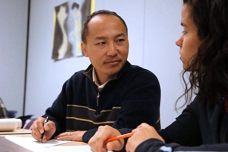 Man helping student with academic questions.