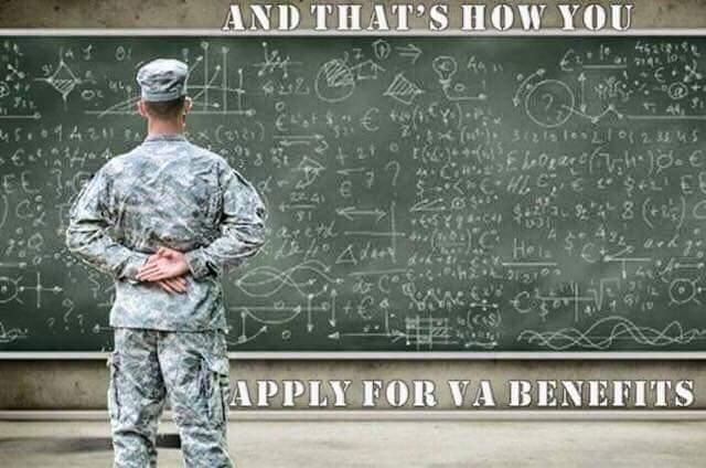 Image of Veteran standing in front of a chalkboard with equations written all of it.