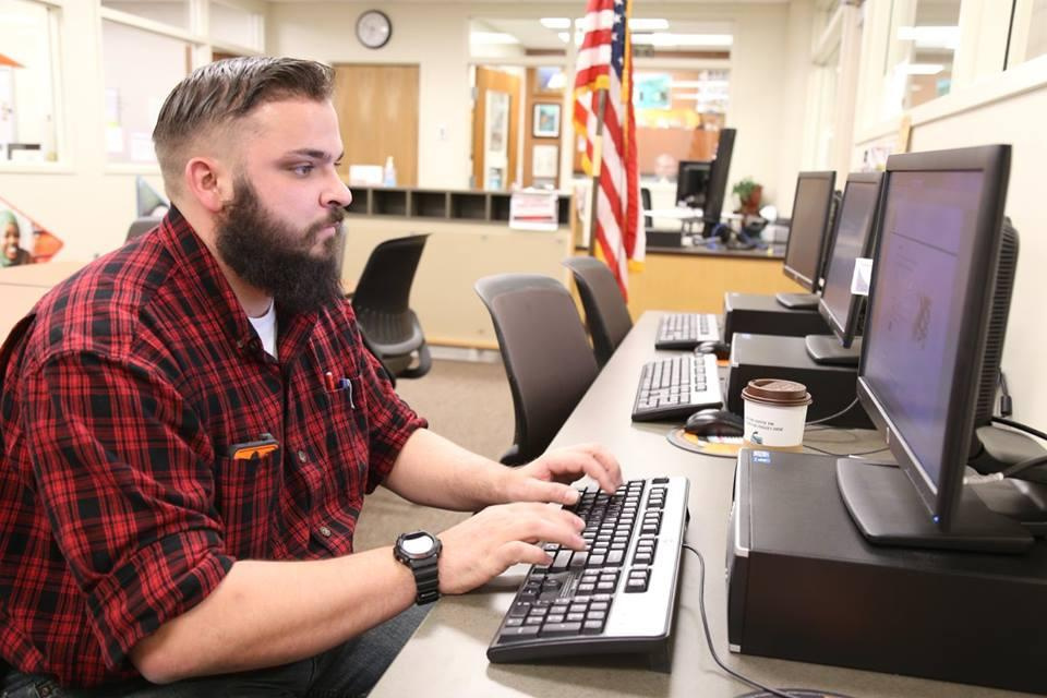 Student studying in the Veterans Center.