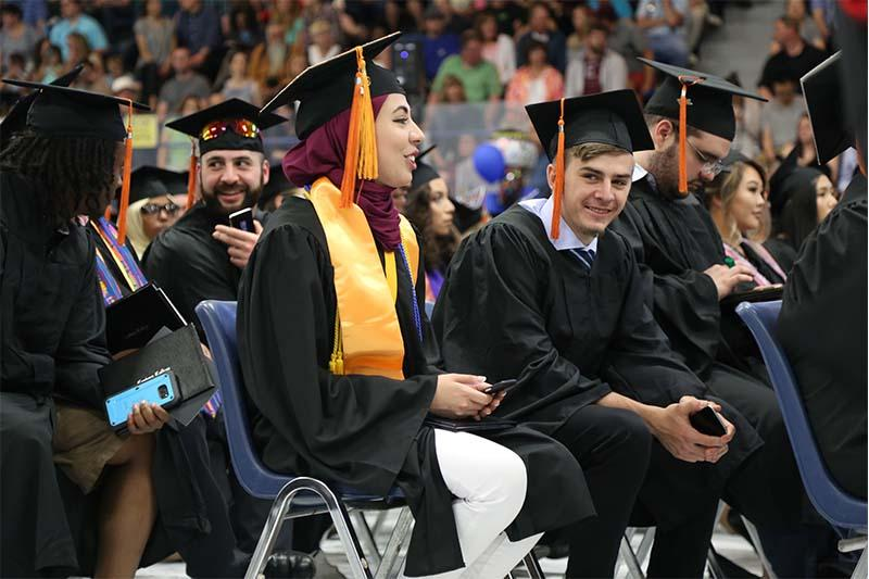 Graduating students with phones 2017