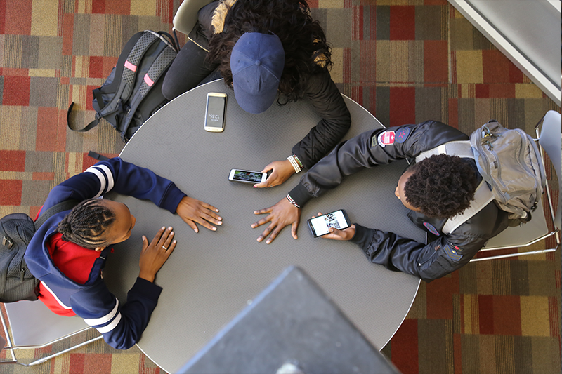 Students sitting around a table