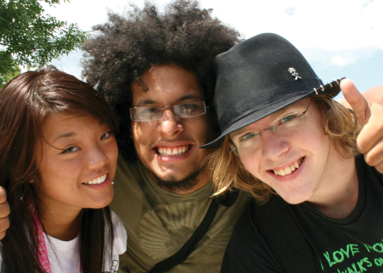 three students smiling for photo