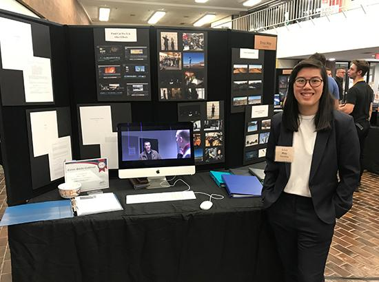 Student presenting her work at the annual portfolio showcase.