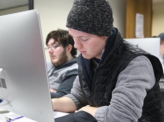 Two design students working in class.