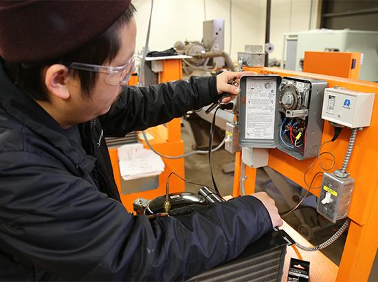 Student working on a heating system.