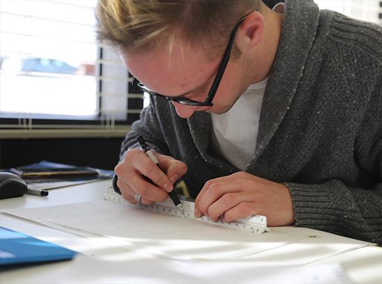 Interior Design student sketching.