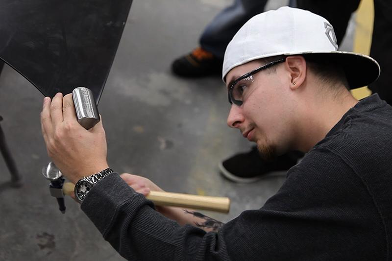 Image of student working with a hammer.