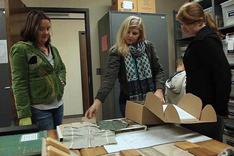 Interior design students looking at fabric samples.