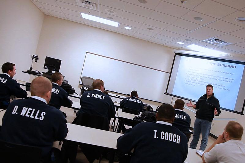 Law enforcement instructor talking to students.