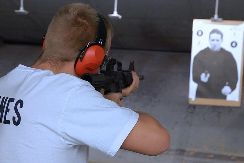 Image of law enforcement student shooting at a shooting range.