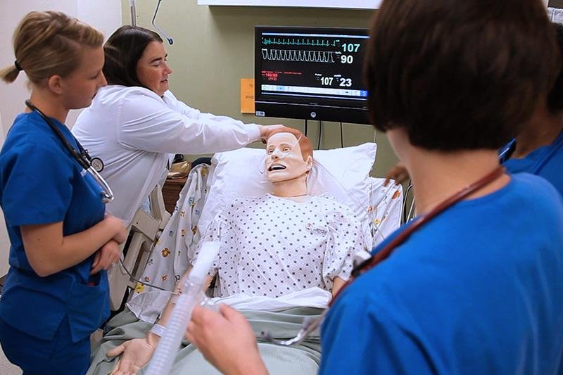Image of nursing student working on a manikin.