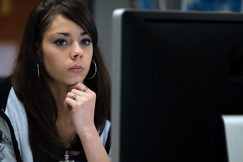 Image of student looking at a computer intently.
