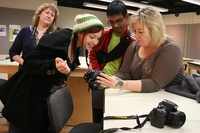Image of students looking at a camera.