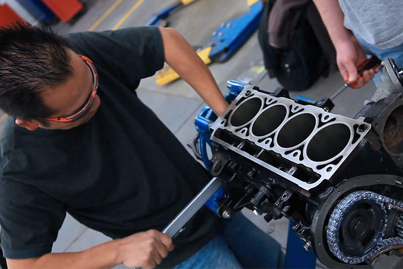 Image of Auto student working on a small engine.