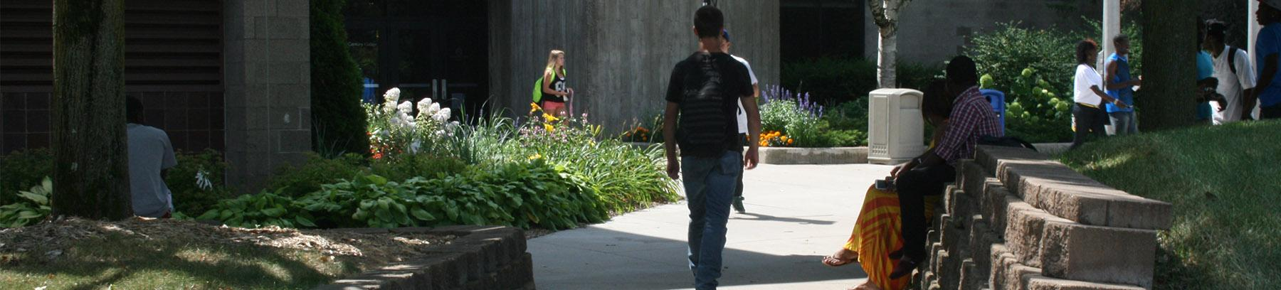 student outside west campus