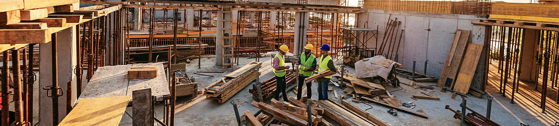 Three men working on a construction site