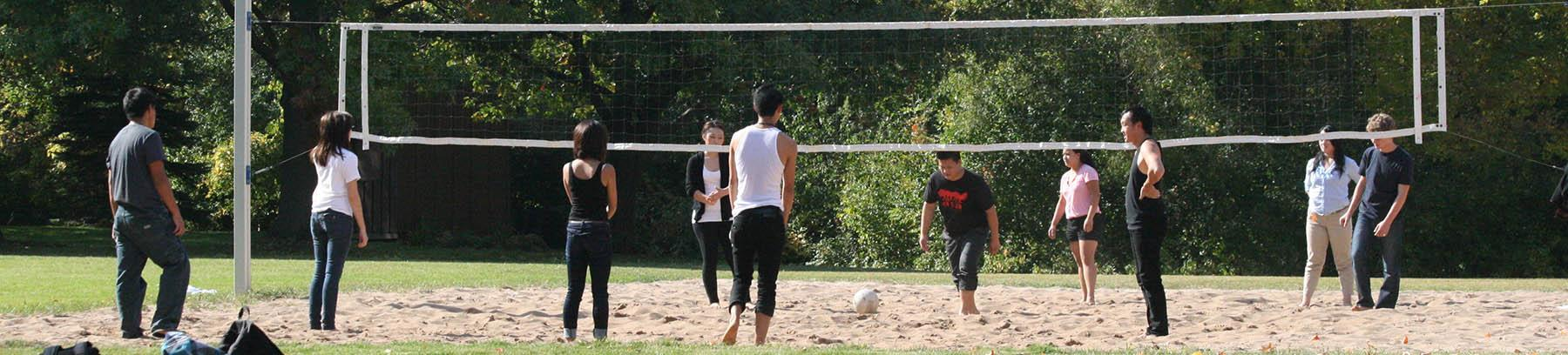 Image of students playing volleyball.