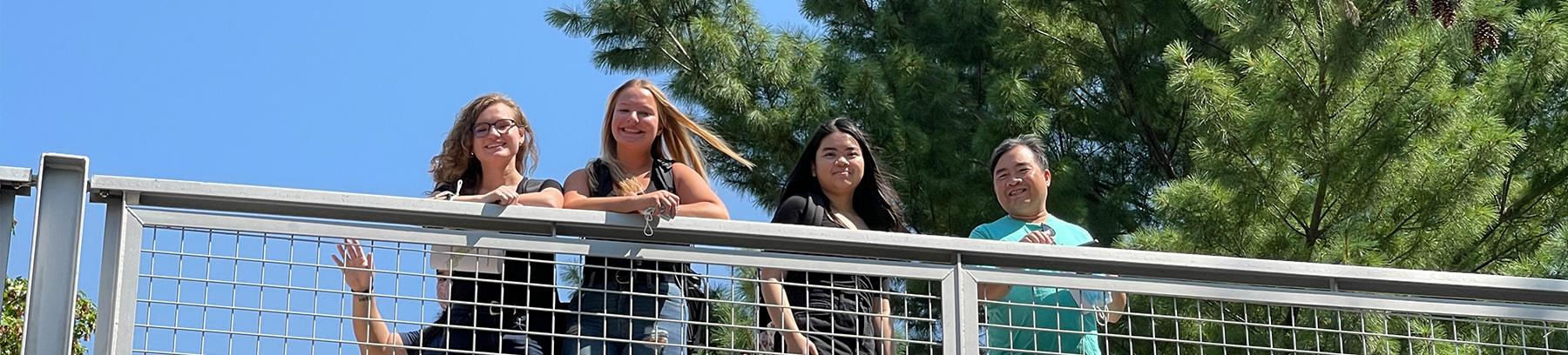 Students standing on the Century bridge