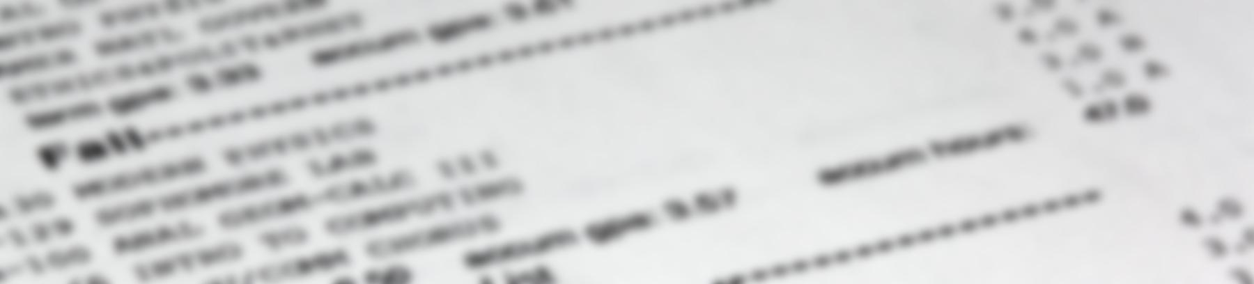 Blurred photo of a college transcript.