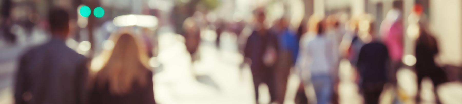 Blurred image of people walking on the street.