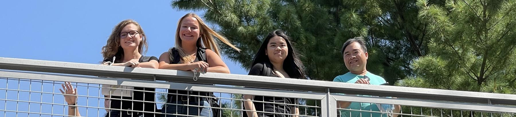 Group of students on the walking bridge that connects East and West campus at Century College.