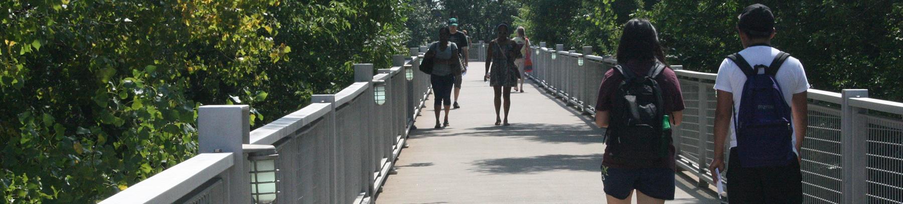Students crossing the walking bridge at Century College.