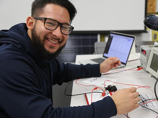 Engineering student working on a project in class.