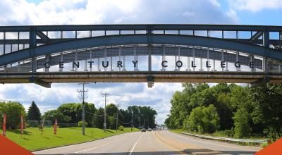 Century College bridge on a sunny day with orange graphic accents on the sides